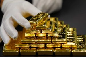 Gold 1 300x200 - An employee sorts gold bars in the Austrian Gold and Silver Separating Plant 'Oegussa' in Vienna